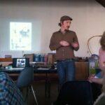 Matt Weir explains his sculpture to staff