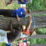 Tom Block, Isaac Bernheim's Great Grandson and current Bernheim Trustee, Dr. Mark Wourms, Bernheim Executive Director, and Kurt Mason, Bernheim Trustee hug a tree on June 4 as part of the Bernheim Big Tree Hug Challenge